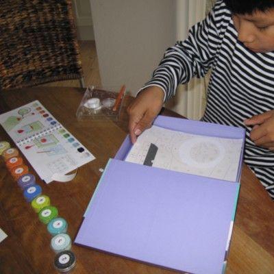 Konst efter nummer - Färgad sand - Världens barn